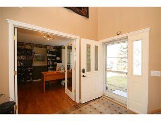 Photo 2: 51 GLENEAGLES View: Cochrane House for sale : MLS®# C4008842