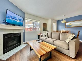 Photo 2: 411 1000 Harvie Heights Road: Harvie Heights Row/Townhouse for sale : MLS®# A1051164