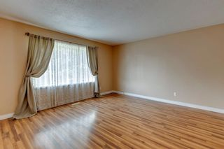 Photo 4: 302 Whitney Crescent SE in Calgary: Willow Park Detached for sale : MLS®# A1146432