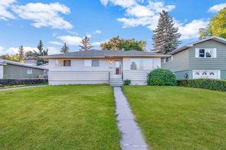 Photo 1: 7827 7 Street SW in Calgary: Kingsland Detached for sale : MLS®# A1030165