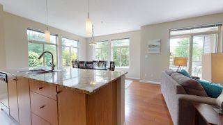 """Photo 1: 206 15322 101 Avenue in Surrey: Guildford Condo for sale in """"Ascada"""" (North Surrey)  : MLS®# R2483343"""
