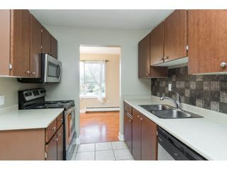 Photo 4: 104 5700 200 STREET in Langley: Langley City Condo for sale : MLS®# R2413141