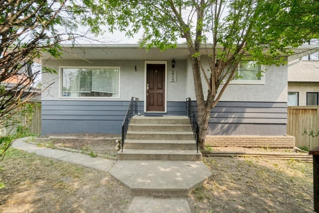 Classic, suited mid century bungalow with brand new shingled roof and freshly painted exterior