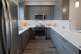 Photo 3: 406 16 Evanscrest Park NW in Calgary: Evanston Row/Townhouse for sale : MLS®# A1130308