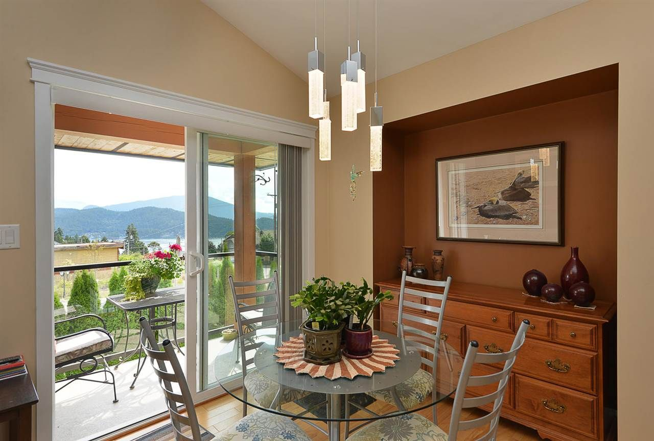 Dining Area with Glass Sliding Doors to outdoor deck with views of the ocean, mountains and islands