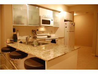 """Photo 6: 214 4028 KNIGHT Street in Vancouver: Knight Condo for sale in """"KING EDWARD VILLAGE"""" (Vancouver East)  : MLS®# V932041"""