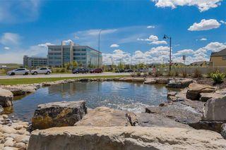 Photo 44: 312 QUARRY Villa SE in Calgary: Douglasdale/Glen Row/Townhouse for sale : MLS®# C4224154