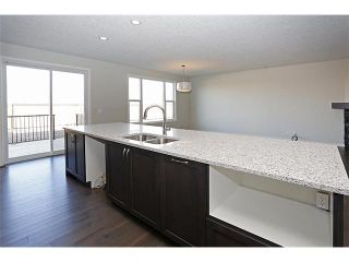 Photo 4: 141 AUBURN MEADOWS Boulevard SE in Calgary: Auburn Bay Residential Detached Single Family for sale : MLS®# C3637003