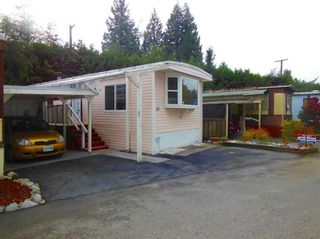 "Photo 11: 15 4200 DEWDNEY TRUNK Road in Coquitlam: Ranch Park Manufactured Home for sale in ""HIDEWAY PARK"" : MLS®# R2124110"