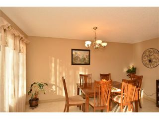 Photo 11: 202 ARBOUR MEADOWS Close NW in Calgary: Arbour Lake House for sale : MLS®# C4048885