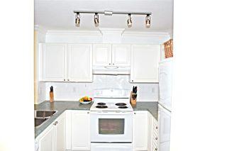 Photo 9: 411 13733 74 Avenue in Surrey: East Newton Condo for sale : MLS®# R2250569