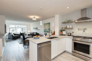 "Photo 2: 405 400 KLAHANIE Drive in Port Moody: Port Moody Centre Condo for sale in ""THE TIDES"" : MLS®# R2512517"