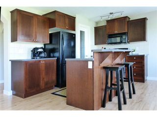 Photo 13: 772 LUXSTONE Landing SW: Airdrie House for sale : MLS®# C4016201