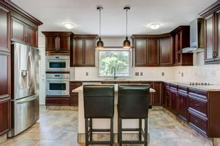 Photo 13: 6131 Lacombe Way SW in Calgary: Lakeview Detached for sale : MLS®# A1129548