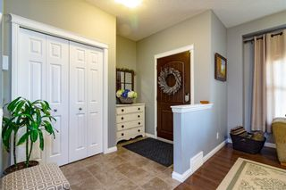 Photo 10: 160 CLYDESDALE Way: Cochrane House for sale : MLS®# C4137001