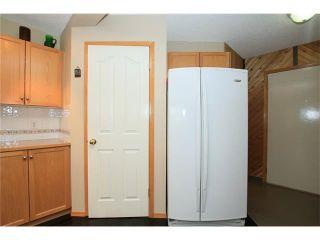 Photo 12: 1 122 BOW RIDGE Crescent: Cochrane House for sale : MLS®# C4073392