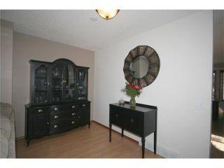 Photo 11: 35 WEST MCDOUGAL Road: Cochrane House for sale : MLS®# C4053037
