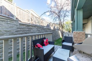 Photo 32: 85 Hidden Creek Rise NW in Calgary: Hidden Valley Row/Townhouse for sale : MLS®# A1104213