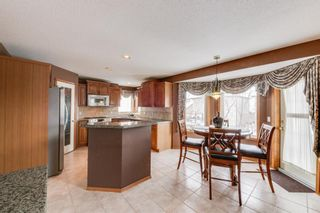 Photo 11: 662 Arbour Lake Drive NW in Calgary: Arbour Lake Detached for sale : MLS®# A1074075