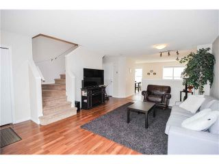Photo 8: 318 TOSCANA Gardens NW in Calgary: Tuscany House for sale : MLS®# C4116517