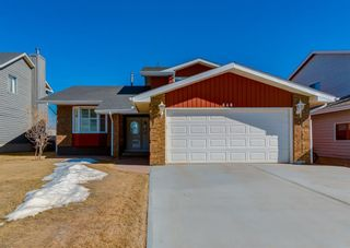 Photo 1: 848 Coach Side Crescent SW in Calgary: Coach Hill Detached for sale : MLS®# A1082611