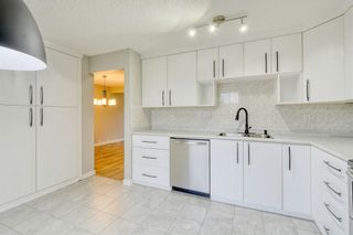 Photo 3: 215 Strathearn Crescent SW in Calgary: Strathcona Park Detached for sale : MLS®# A1146284