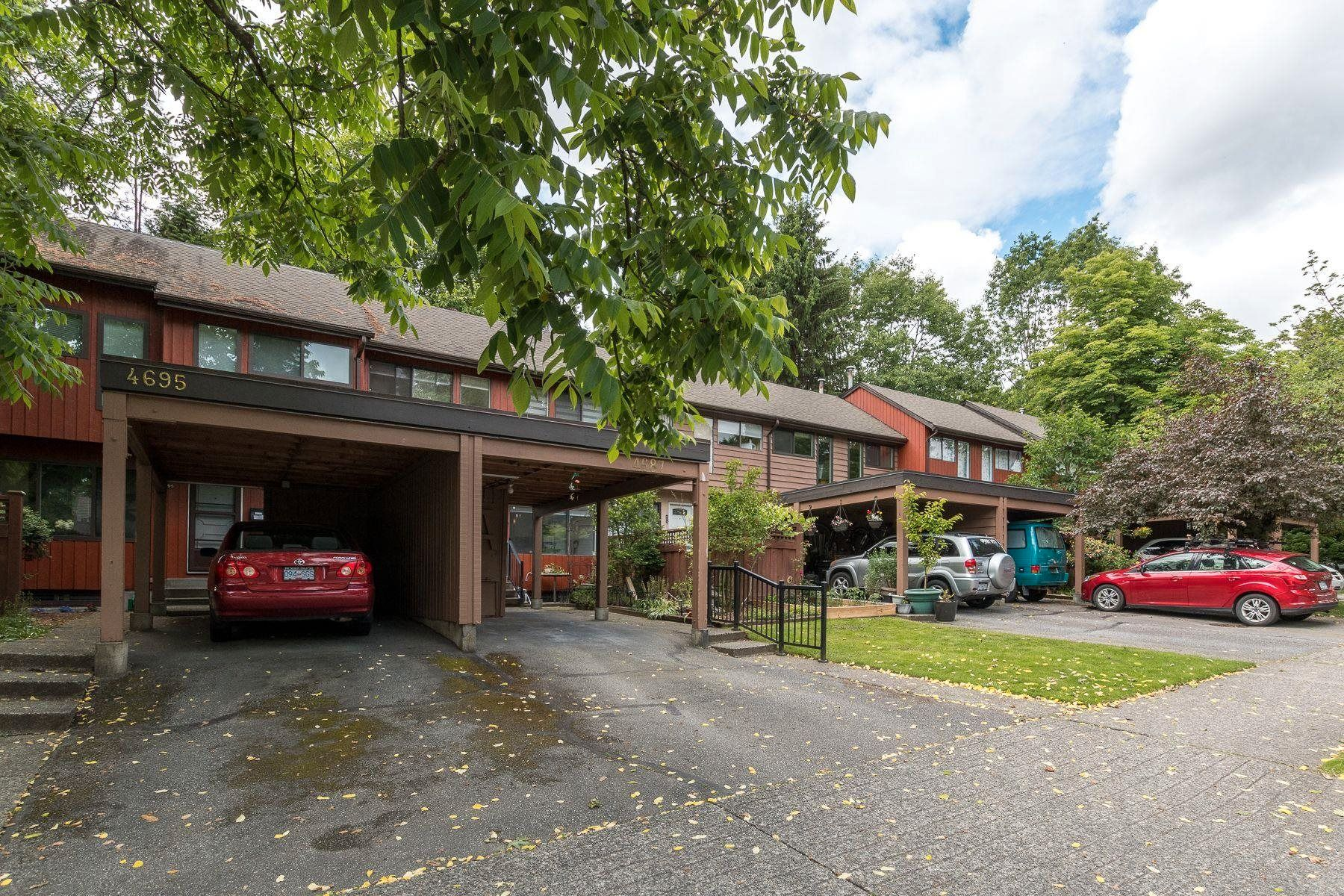 """Main Photo: 4687 GARDEN GROVE Drive in Burnaby: Greentree Village Townhouse for sale in """"Greentree Village"""" (Burnaby South)  : MLS®# R2608954"""