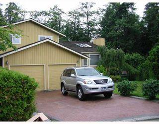 "Photo 1: 35 ESCOLA Bay in Port_Moody: Barber Street House for sale in ""BARBER/APRIL RD"" (Port Moody)  : MLS®# V773870"