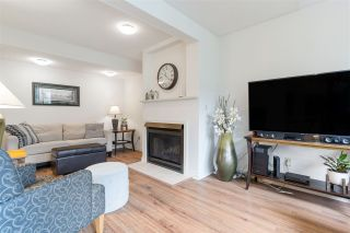 """Photo 1: 8552 WILDERNESS Court in Burnaby: Forest Hills BN Townhouse for sale in """"SIMON FRASER VILLAGE"""" (Burnaby North)  : MLS®# R2560029"""
