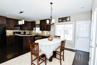 Photo 11: 304 CIMARRON VISTA Way: Okotoks House for sale : MLS®# C4172513