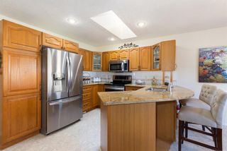 Photo 4: 144 Harrison Court: Crossfield Detached for sale : MLS®# A1086558