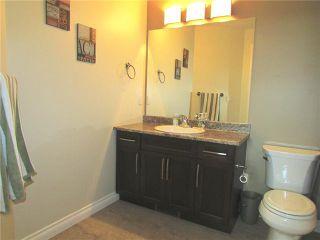 """Photo 11: 10409 109TH Street in Fort St. John: Fort St. John - City NE 1/2 Duplex for sale in """"SUNSET RIDGE"""" (Fort St. John (Zone 60))  : MLS®# N229918"""