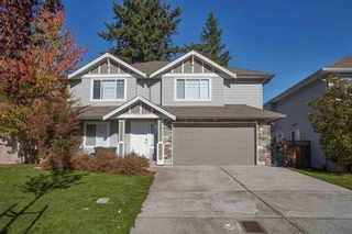 Photo 1: 27229 27 Avenue in Langley: Aldergrove Langley House for sale : MLS®# R2605928