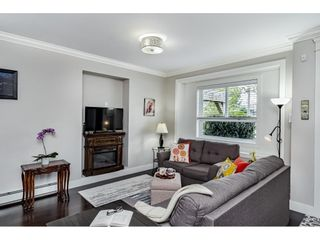 """Photo 4: 101 3488 SEFTON Street in Port Coquitlam: Glenwood PQ Townhouse for sale in """"SEFTON SPRINGS"""" : MLS®# R2572940"""