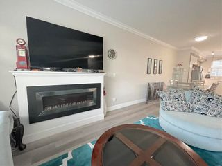 Photo 2: 35 6350 142 Street in Surrey: Sullivan Station Townhouse for sale : MLS®# R2567363