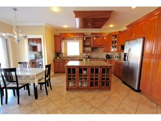 Photo 5: 8075 135A Street in Surrey: Queen Mary Park Surrey House for sale : MLS®# F1444482