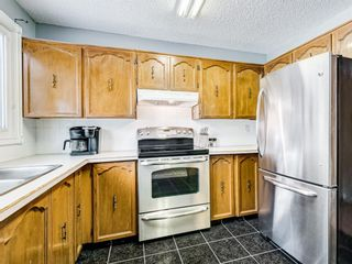 Photo 5: 11 1111 Canterbury Drive SW in Calgary: Canyon Meadows Row/Townhouse for sale : MLS®# A1067418