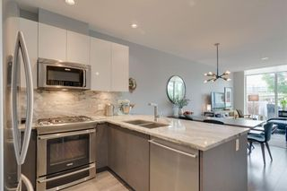 Photo 13: 113 Confluence Mews SE in Calgary: Downtown East Village Row/Townhouse for sale : MLS®# A1138938