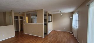 Photo 2: E 1215 44 Street SE in Calgary: Forest Lawn Row/Townhouse for sale : MLS®# A1104267