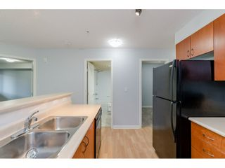 """Photo 6: 209 5465 203 Street in Langley: Langley City Condo for sale in """"Station 54"""" : MLS®# R2394003"""