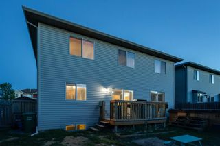 Photo 43: 704 Luxstone Square SW: Airdrie Detached for sale : MLS®# A1133096