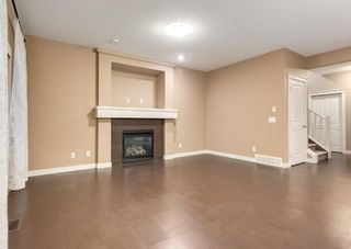 Photo 5: 150 AUTUMN Circle SE in Calgary: Auburn Bay Detached for sale : MLS®# A1089231