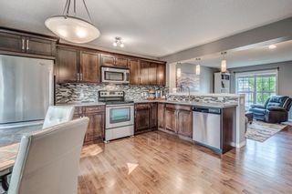 Photo 10: 61 Auburn Springs Boulevard SE in Calgary: Auburn Bay Semi Detached for sale : MLS®# A1135621