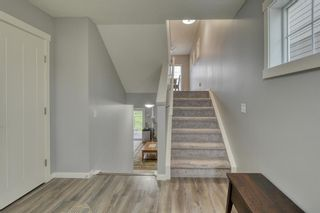 Photo 4: 643 101 Sunset Drive N: Cochrane Row/Townhouse for sale : MLS®# A1117436