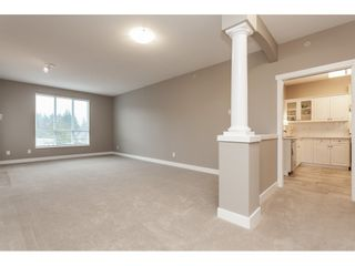 "Photo 3: #402 13860 70 Avenue in Surrey: East Newton Condo for sale in ""Chelsea Gardens"" : MLS®# R2435738"