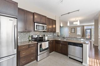 Photo 7:  in Calgary: Evanston Row/Townhouse for sale : MLS®# A1073817