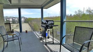 Photo 11: 407 7239 SIERRA MORENA Boulevard SW in Calgary: Signal Hill Apartment for sale : MLS®# C4303319
