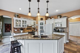 Photo 9: 61 Strathridge Crescent SW in Calgary: Strathcona Park Detached for sale : MLS®# A1152983