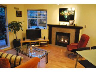 """Photo 1: 103 1959 W 2ND Avenue in Vancouver: Kitsilano Condo for sale in """"CARMEL PLACE"""" (Vancouver West)  : MLS®# V887006"""
