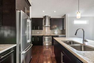 Photo 8: 105 Silverado Bank Circle SW in Calgary: Silverado Detached for sale : MLS®# A1153403